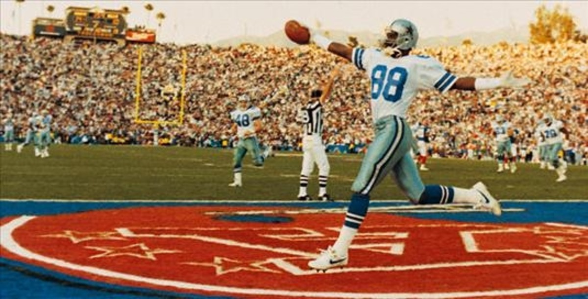 Michael Irvin scoring a touchdown in Super Bowl XXVII.
