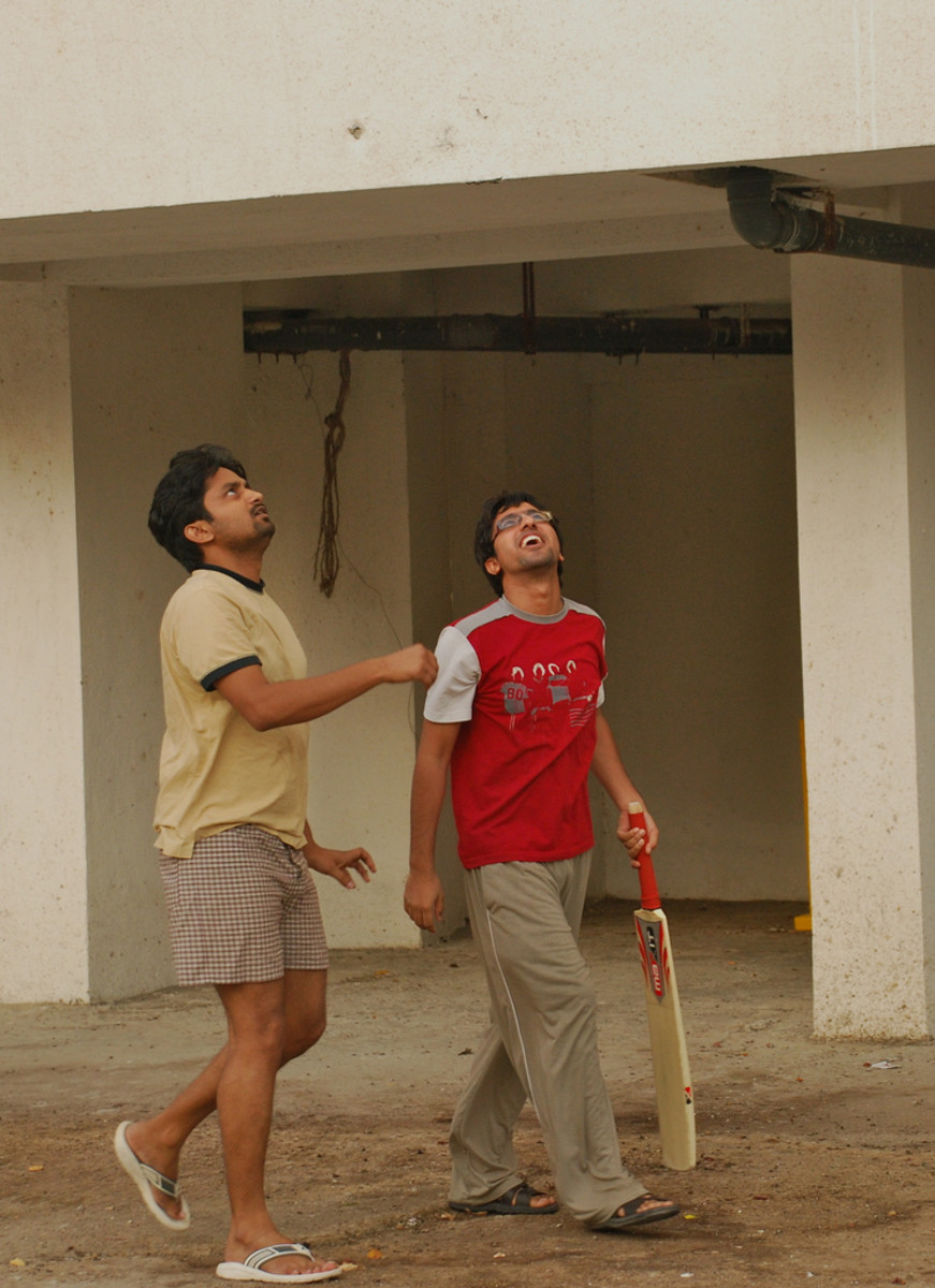 two men preparing for a game of cricket