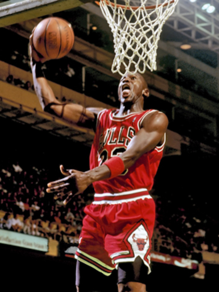 Classic image of Jordan sticking his tongue out while dunking.