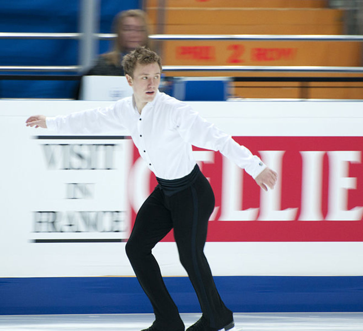 A skater using backwards crossovers prior to a jump.