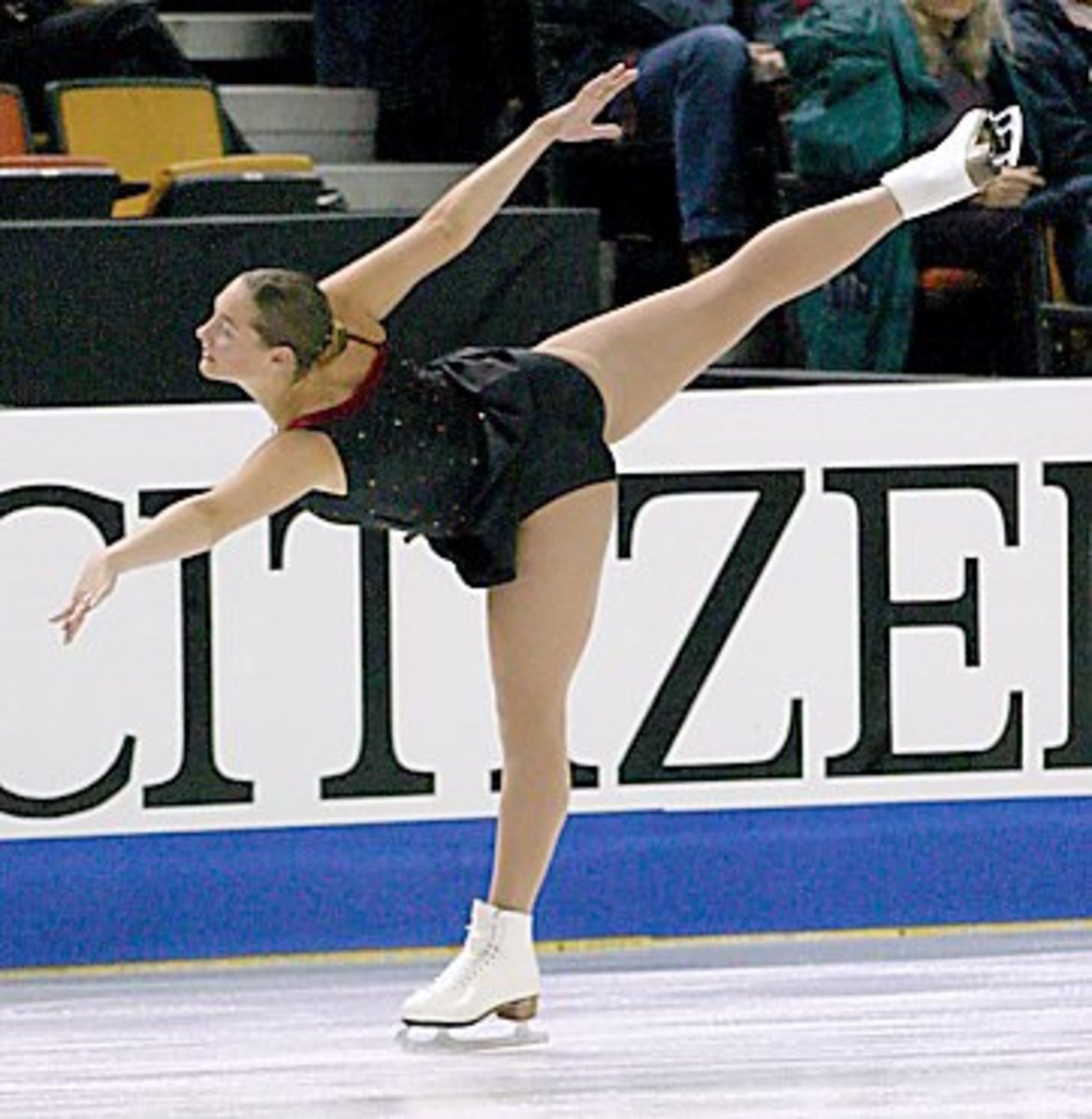 This is a move called the spiral. The skater's free leg must reach hip level or higher for it to be considered a good position. The most flexible skaters basically do a standing split.