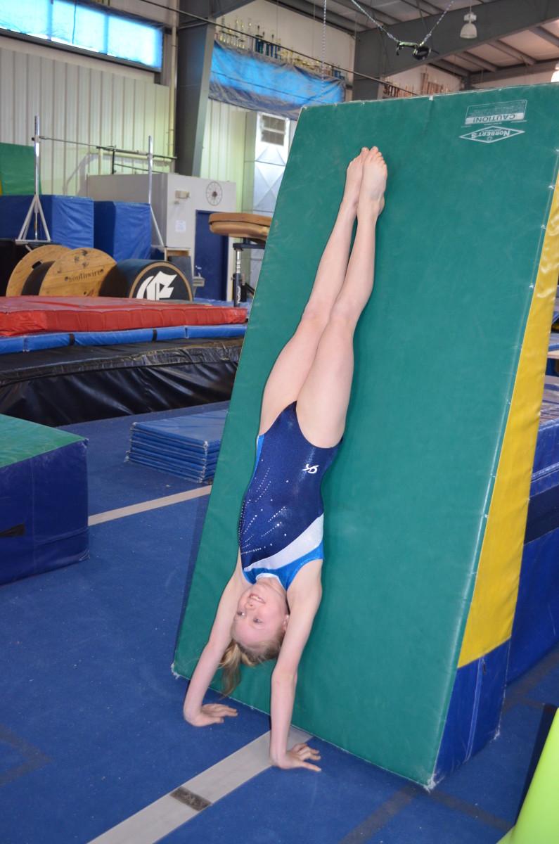 Handstand against mat
