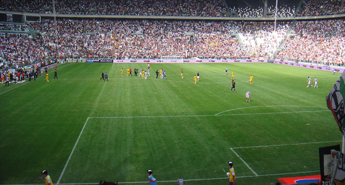 Juventus F.C.'s 2011–2012 team, the 'Juventus Invincibles', is one of the teams that gets an honorable mention on this list. In this 2011 photo, the team plays Parma in the first competitive match in the Juventus Stadium.