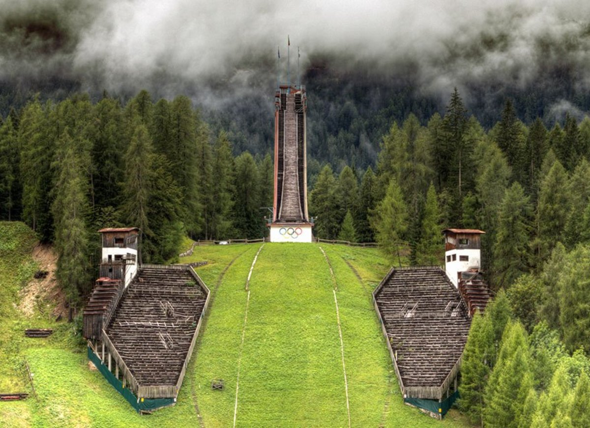 The silent ski jump, Trampolino Olimpico, still carries the Olympic Rings but hasn't carried an event since 1990.