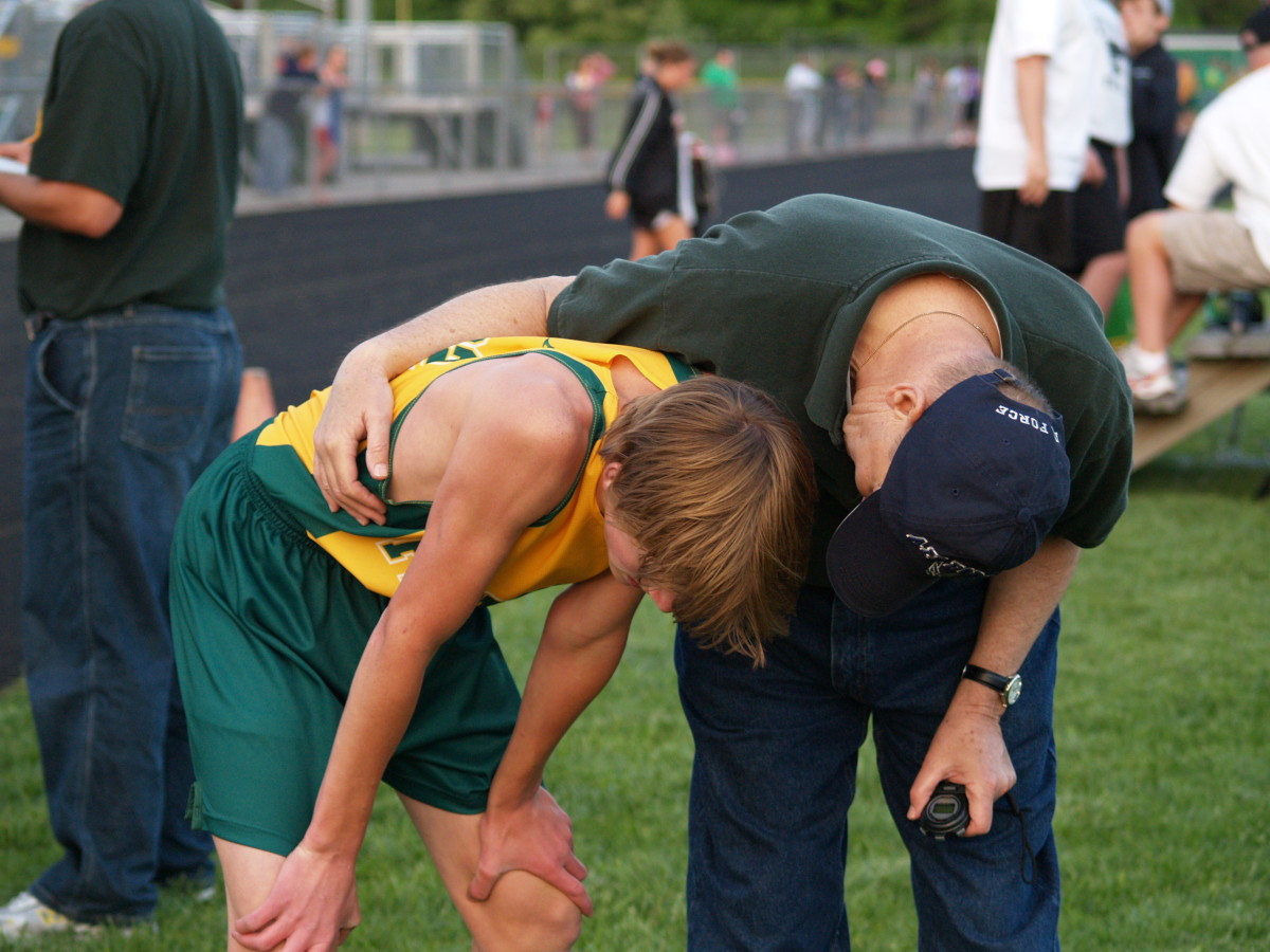 Race volunteer helping a runner