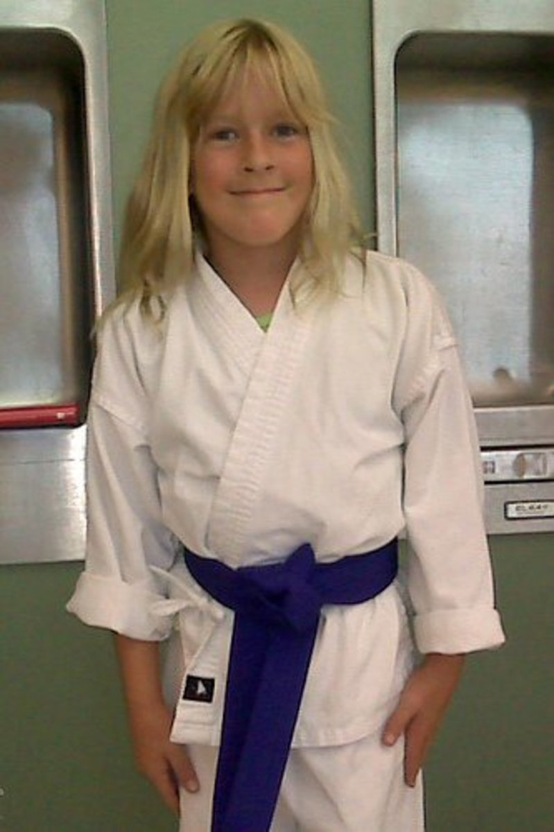 A girl with the rank of purple belt.