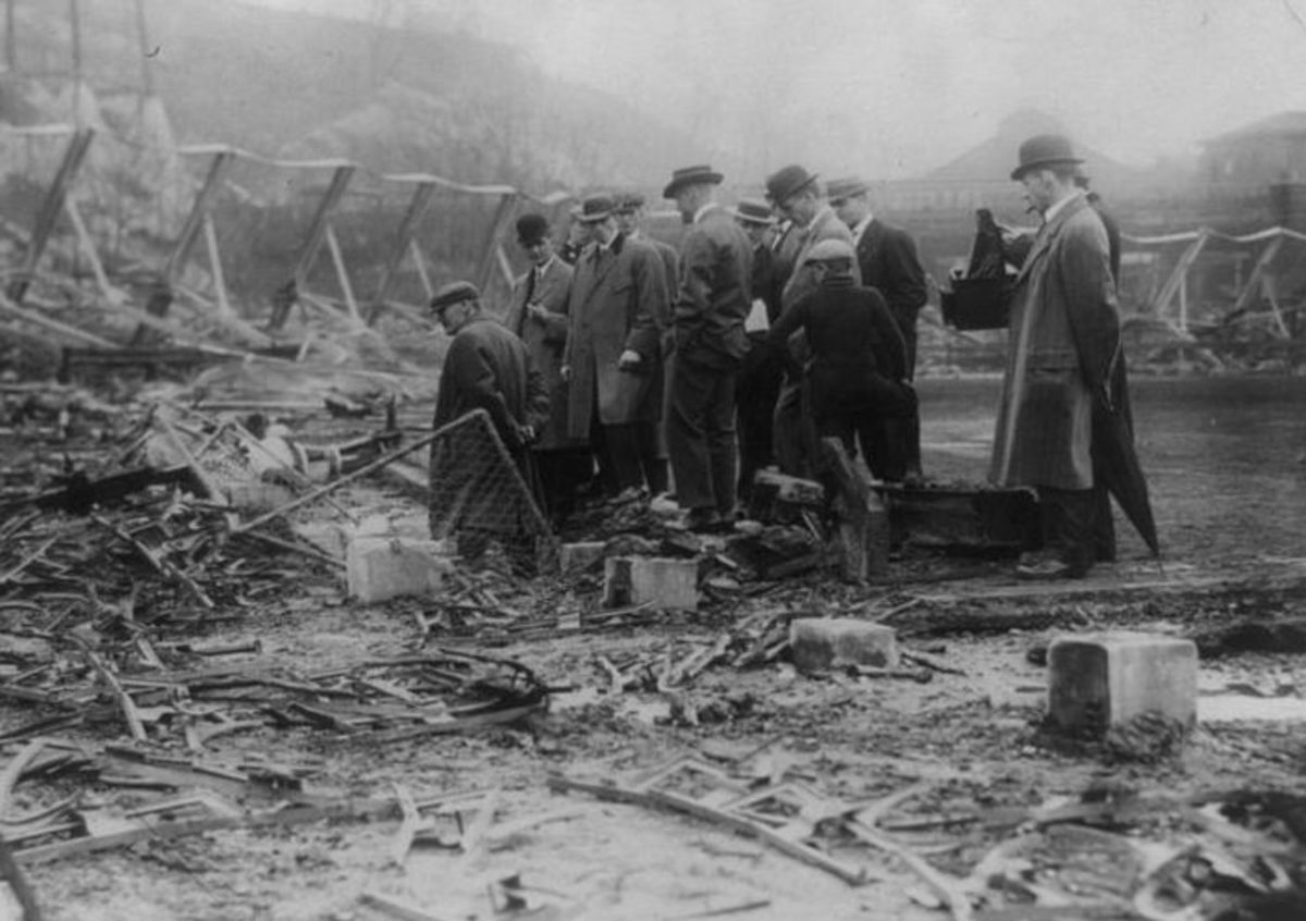 Inspecting the ruins following a fire at the Polo Grounds; April, 1911. (New York Giants)