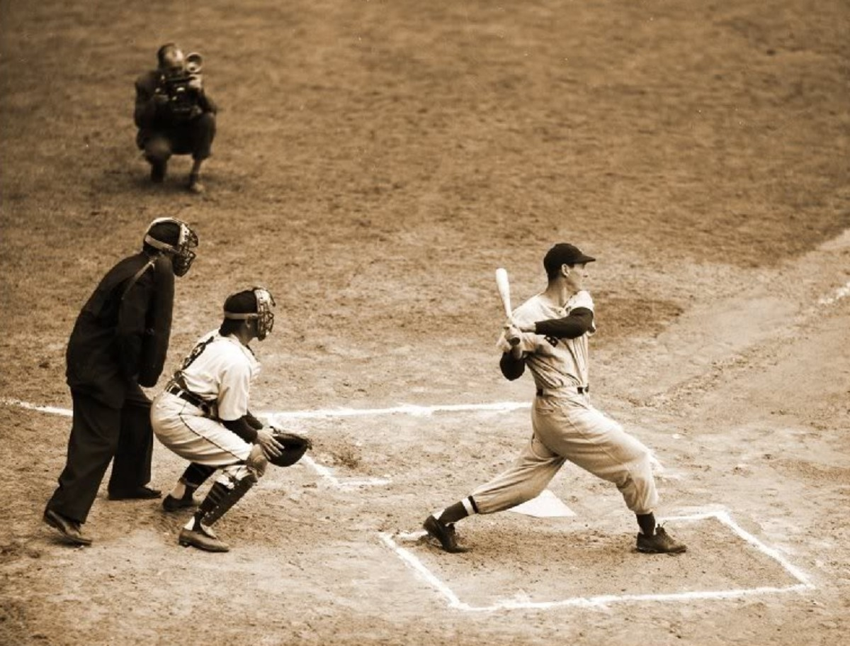 Ted Williams finishes his swing