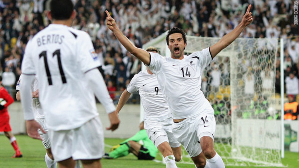 Rory Fallon (14) of New Zealand celebrates with teammates after scoring the decisive goal for New Zealand in a World Cup playoff against Bahrain.