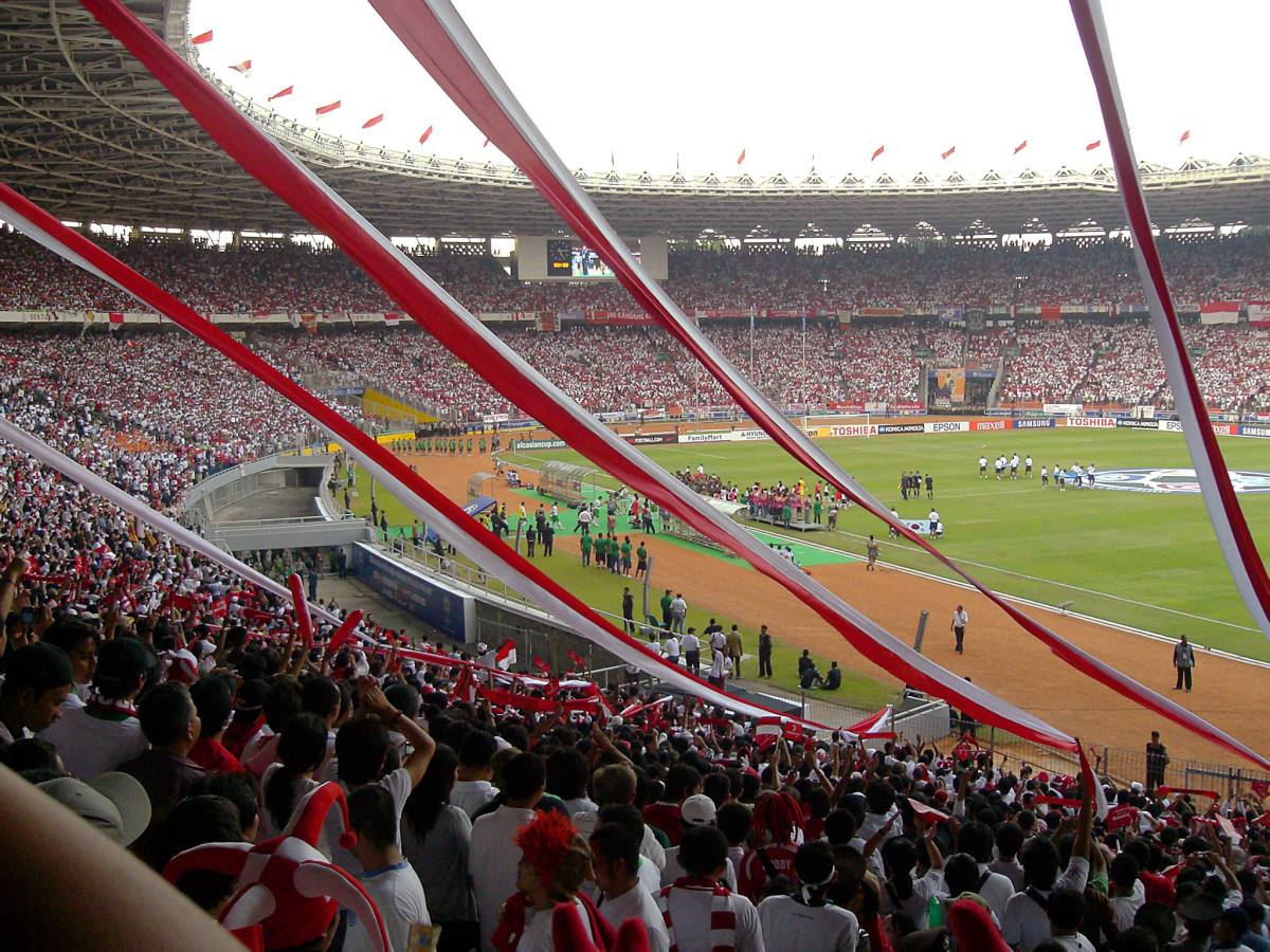 Fans at Gelora Bung Karno Stadium watch as Indonesia hosts South Korea in a 2007 group stage match.