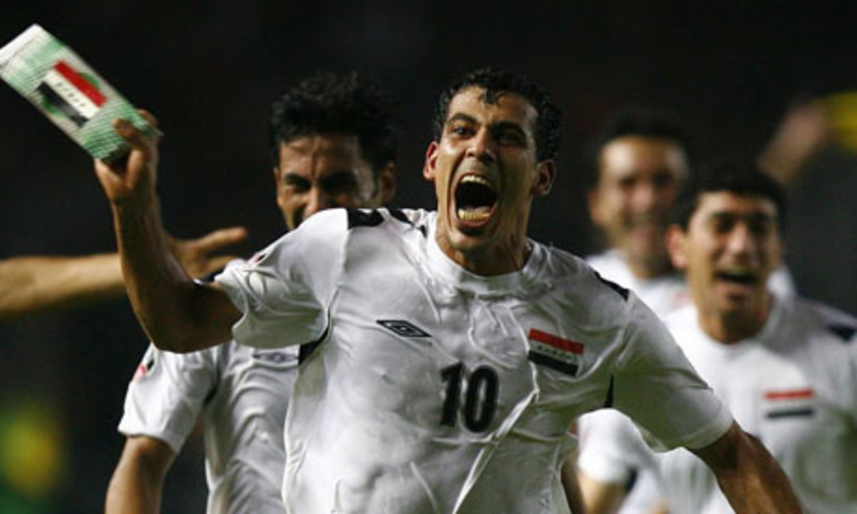 Younis Mahmoud (10) celebrates with teammates behind him after scoring against Saudi Arabia to give Iraq its first Asian Cup.
