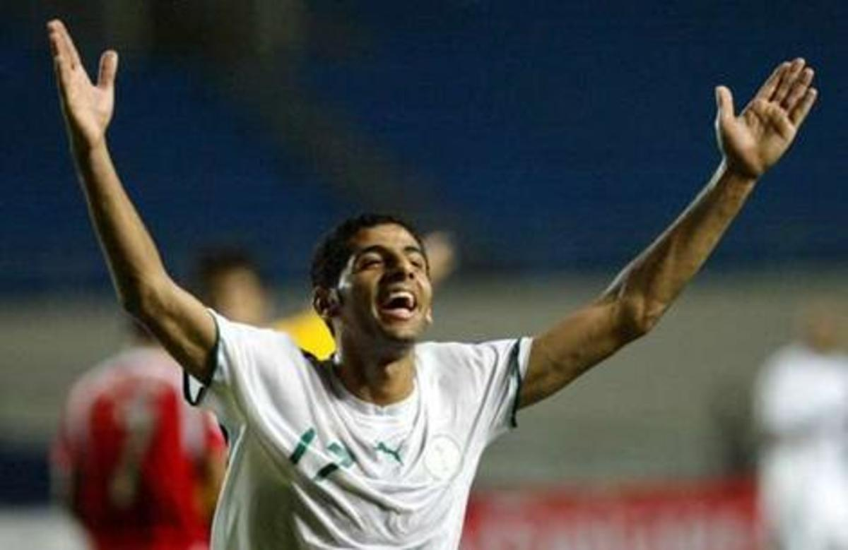 Taisir Al-Jassim of Saudi Arabia celebrates after scoring against Bahrain in a group stage match in Palembang, Indonesia. Saudi Arabia won 4-0 to eliminate its opponents from the tournament.