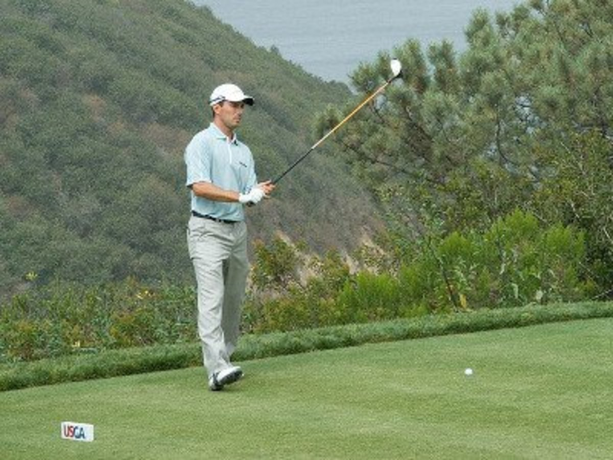 Golfer executing a pre-shot routine.