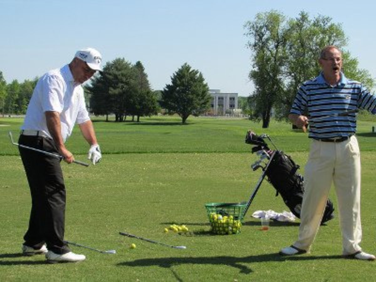 Clubs on ground to help with alignment
