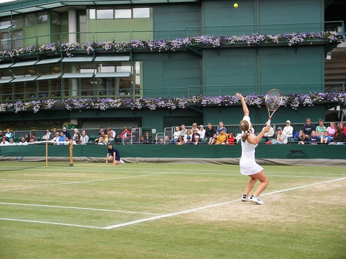 """Simona Halep serving. The Romanian professional has scrappy style and describes herself as """"an aggressive baseliner."""" She is an excellent counterpuncher and very athletic on court."""
