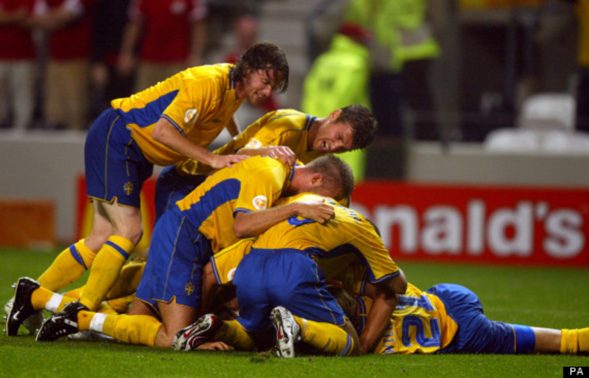 Swedish players come over to congratulate Mattias Jonson after scoring the tying goal in a Euro 2004 match against Denmark. Jonson's goal made the match 2-2 and the result was what got Sweden and Denmark through to the quarterfinals.
