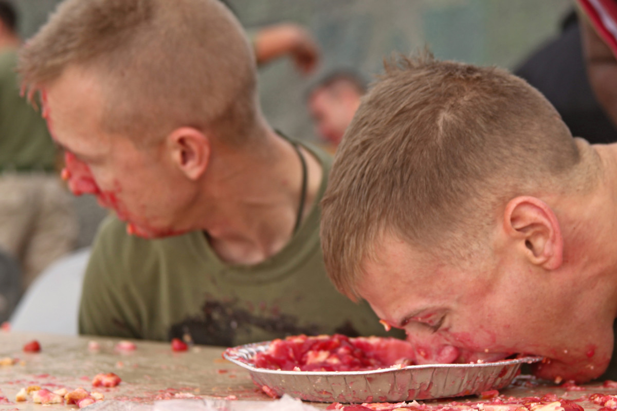 "Professional speed eaters can earn thousands of dollars in prizes, but many speed eaters are one-time or occasional participants in local ""just for fun"" contests, like these Marines."