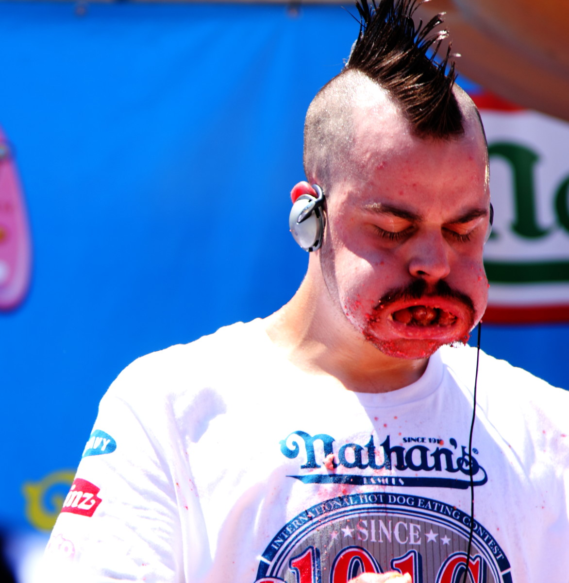 "Oh, gross. American competitive eater Patrick ""Deep Dish"" Bertoletti fills his mouth with hot dogs in the 2010 Nathan's Hot Dog Eating Contest. He placed third in the competition."