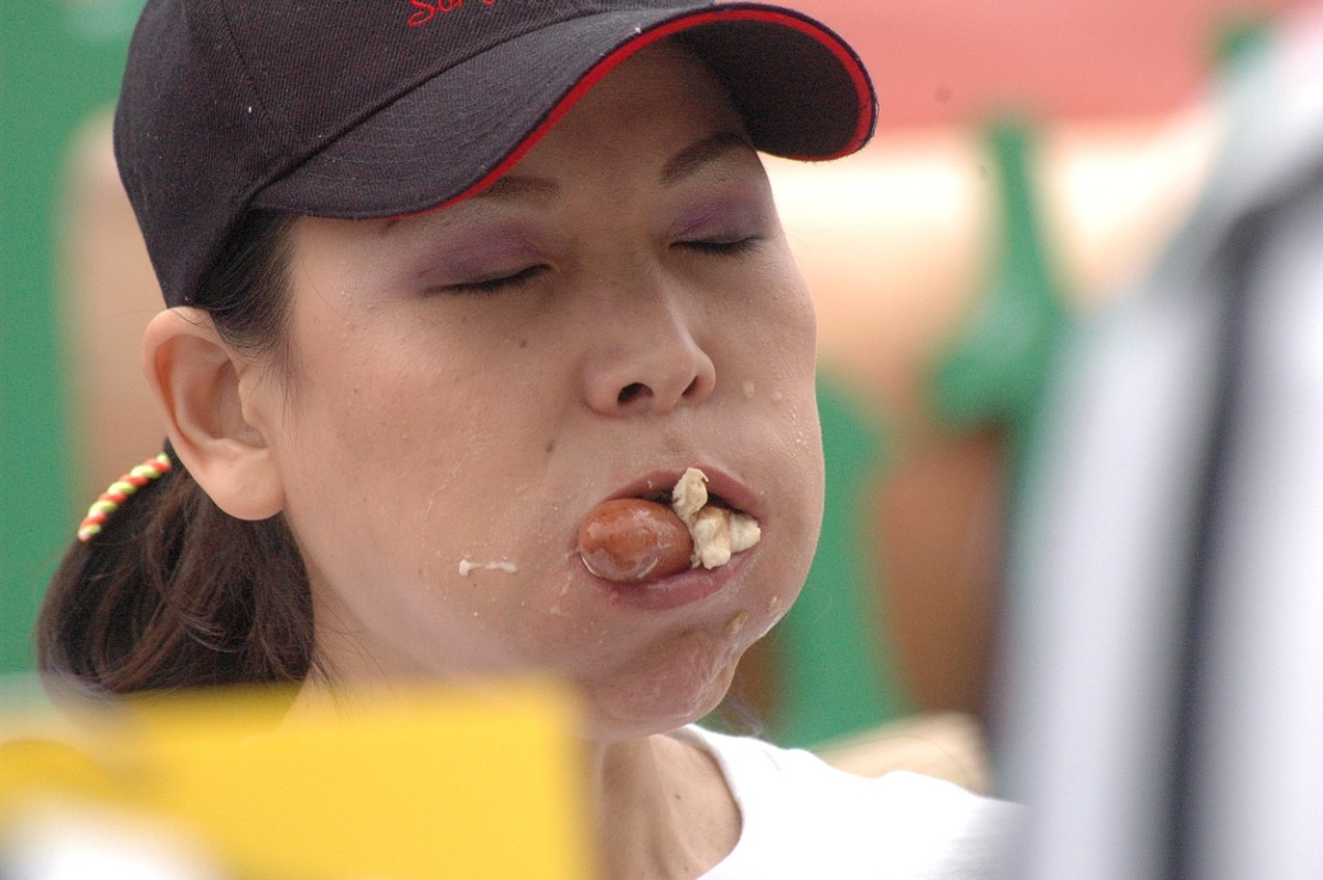 "Competitive eater Sonya ""The Black Widow"" Thomas in a Nathan's Hot Dog Eating Contest.  In 2011, she won $10,000 for eating 40 hot dogs and buns in 10 minutes."