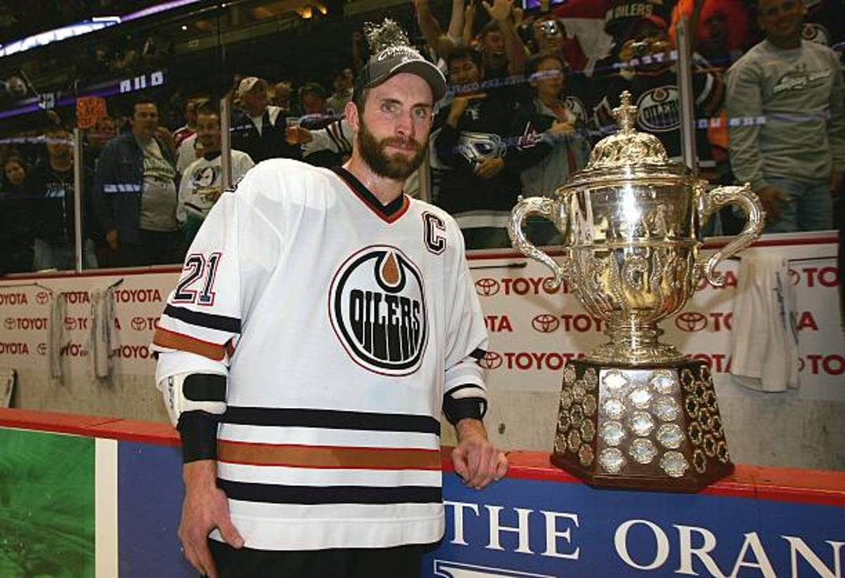 Captain Jason Smith with the Clarence Campbell trophy