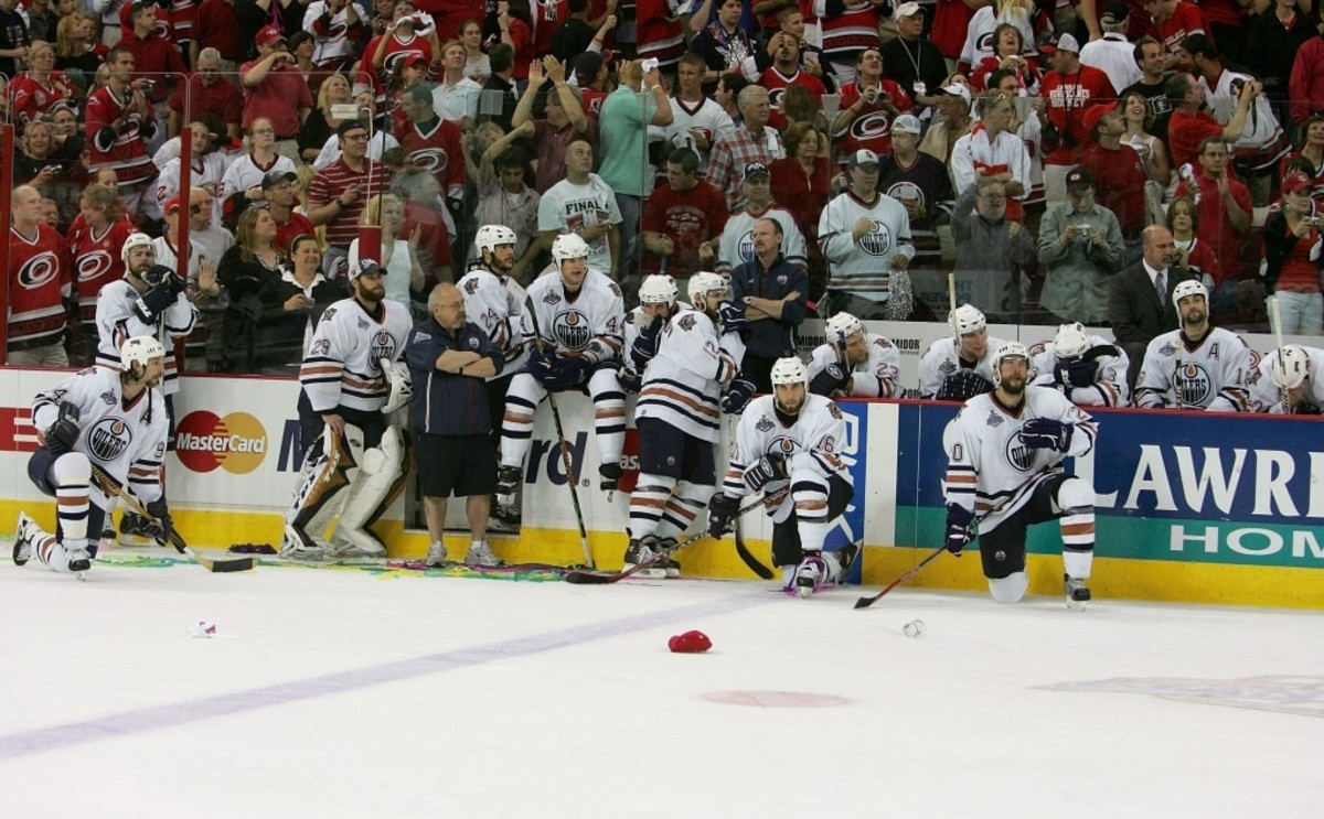 The Oilers watch as the Hurricanes celebrate