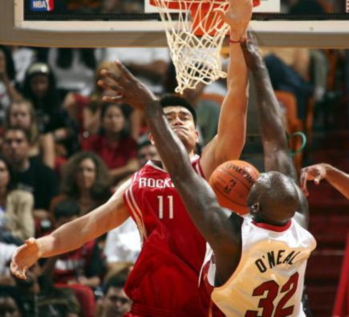 Yao Ming humiliates Shaquille O' Neil by blocking his shot..