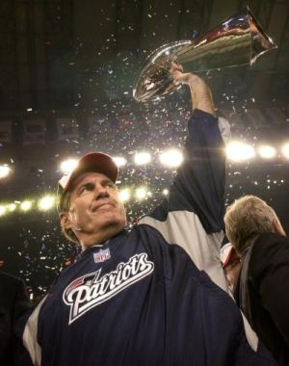 Bill Belichick holding the Super Bowl trophy.