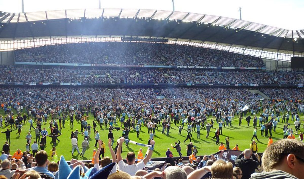 Manchester City fans invading the pitch after their last gasp title victory in 2012. It was their first title in the Premier League era and their first top division title since 1968.
