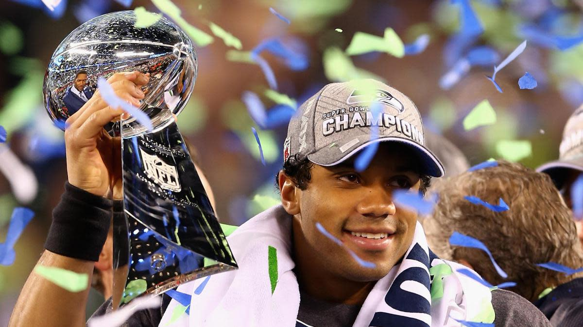 Russell Wilson hoists the Lombardi Trophy after his Super Bowl XLVIII victory.