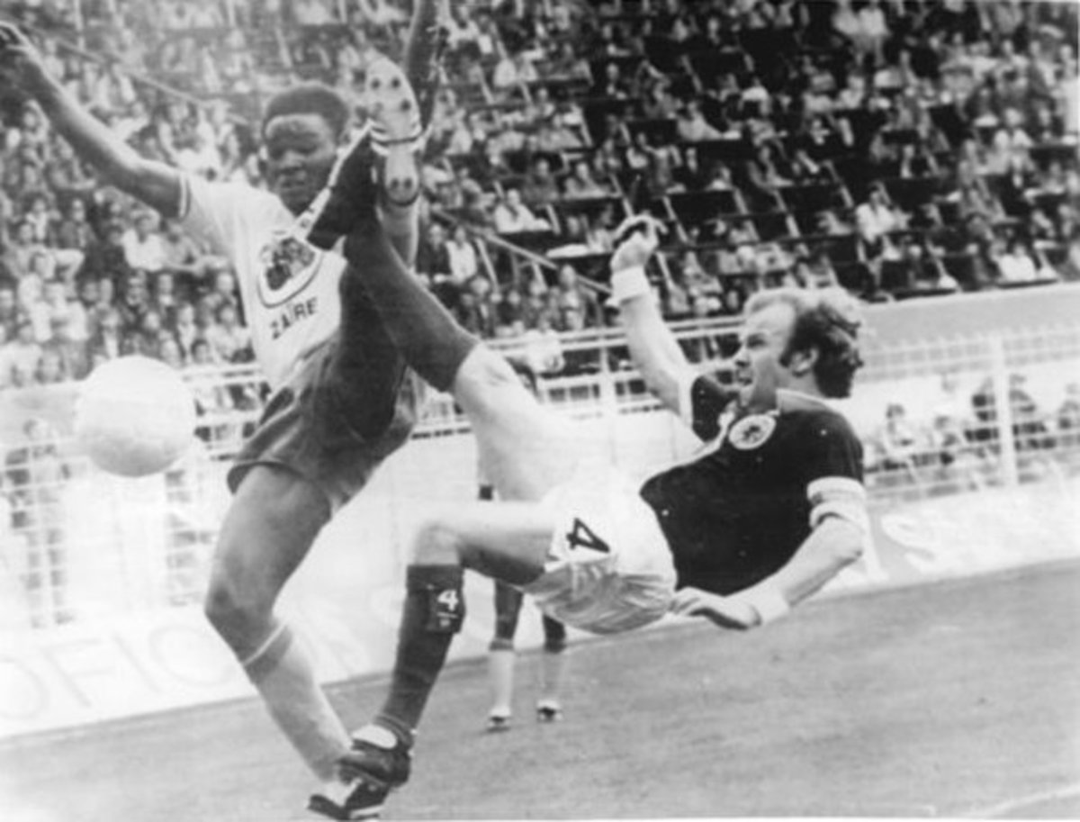 A photo of Scotland's Billy Bremner challenging for the ball in a match against Zaire in the 1974 FIFA World Cup.