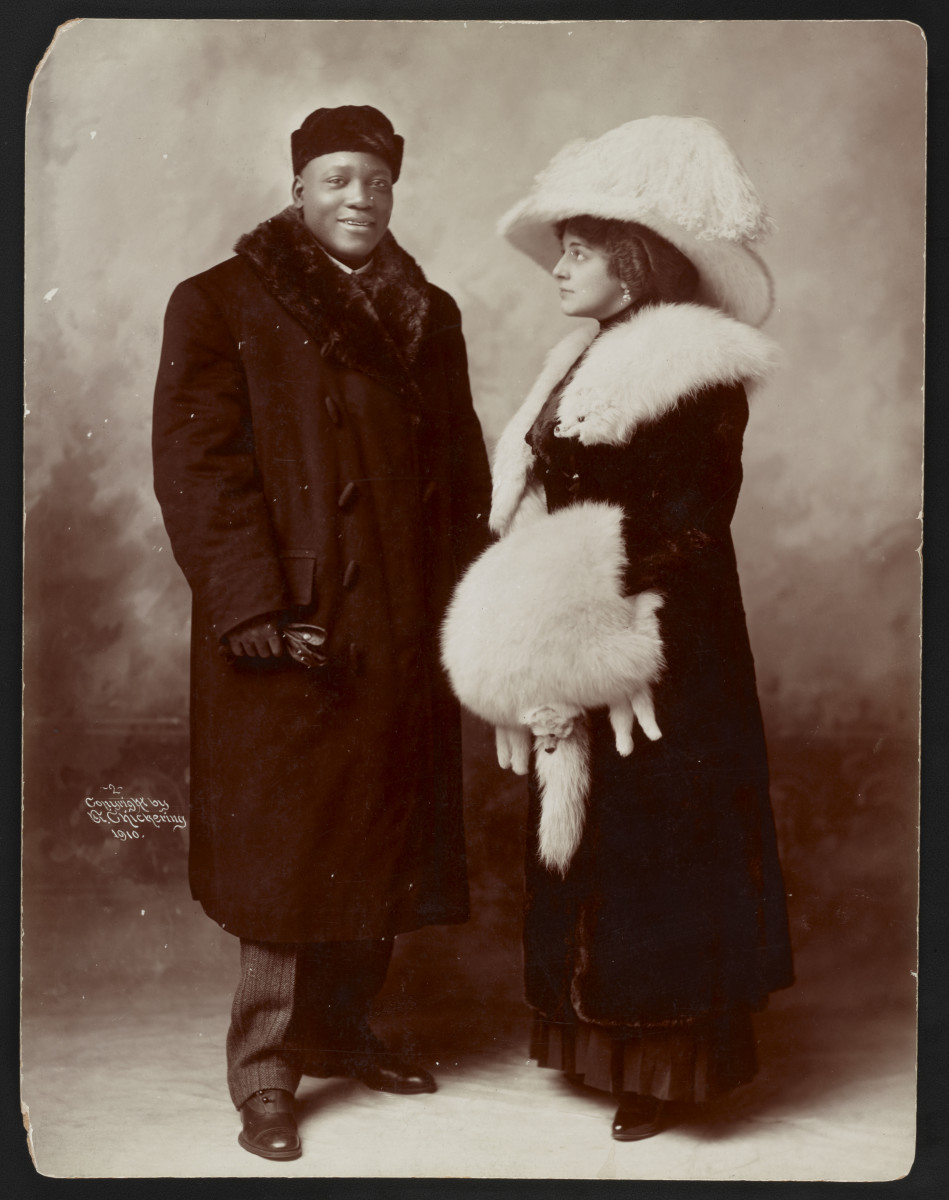 Boxing Champion and his wealthy wife pose for the cameras.