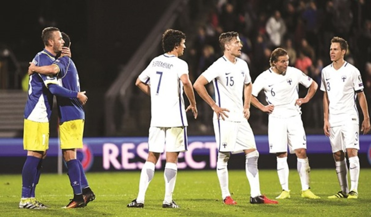 Finland's players (white) stand dejected following the conclusion of its opening 2018 FIFA World Cup qualifier on Sept. 3, 2016. Finland managed a 1-1 draw against Kosovo, its opponents having made its World Cup qualifying debut.