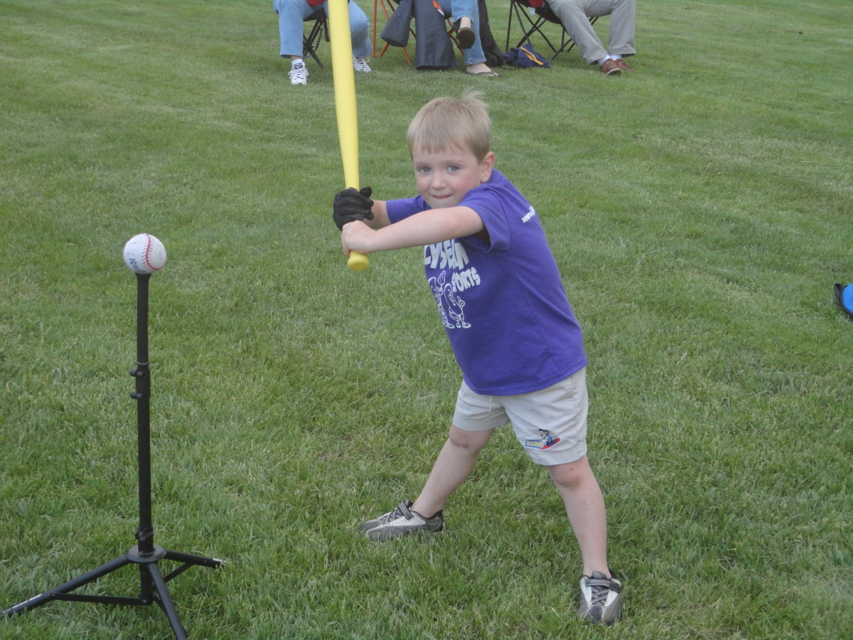 Boy's exaggerated hitting stance