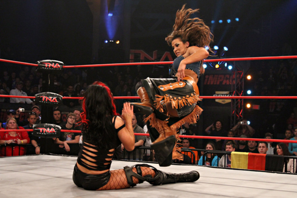 Mickie James about to nail Tara with a dropkick