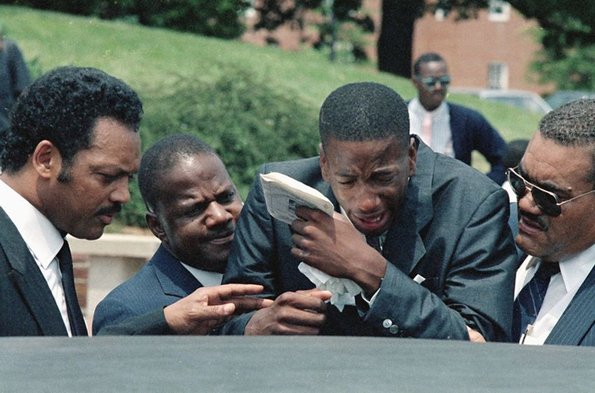 Len's brother Jay being consoled by Jesse Jackson (far left) and his father James (2nd left) Jay would be murdered 5 years later.