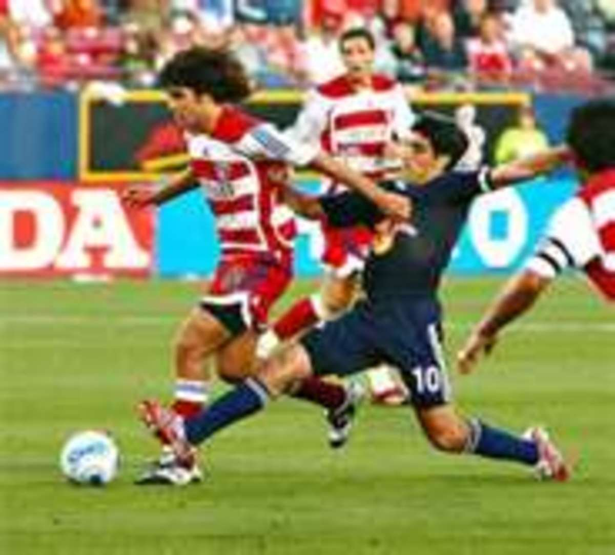 Former US captain Claudio Reyna with a textbook poke tackle.