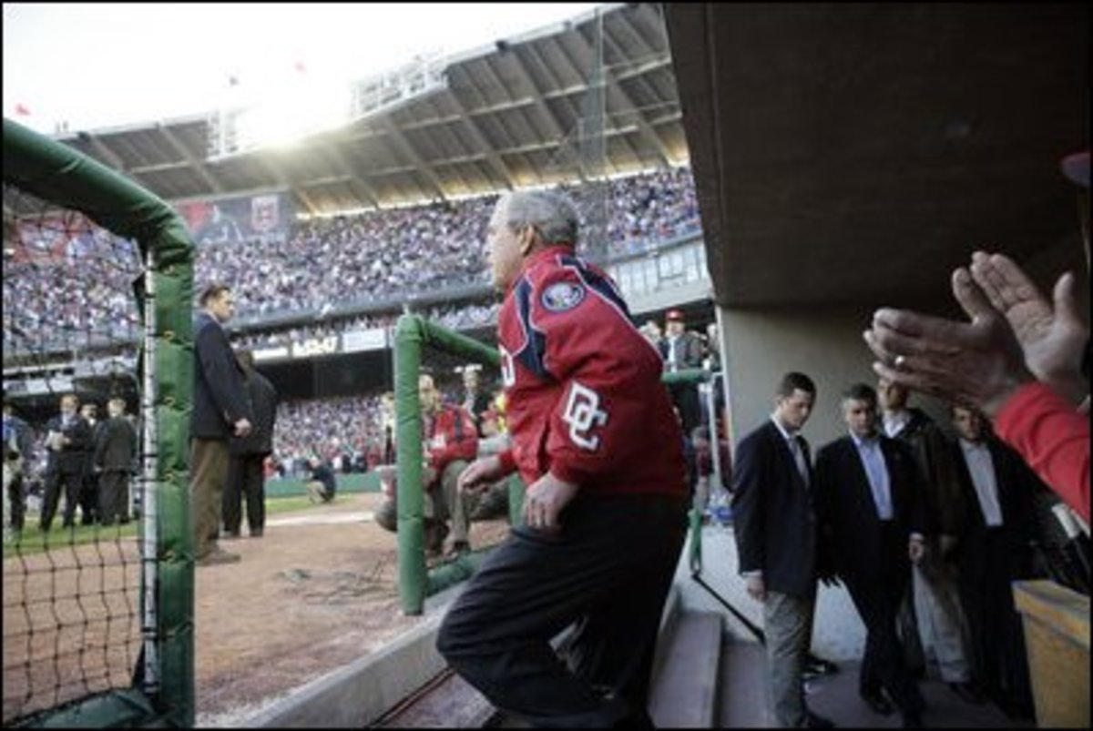 President George W. Bush prepares to throw out the first pitch at the Opening Day game of the Washington Nationals' 2005 inaugural season.