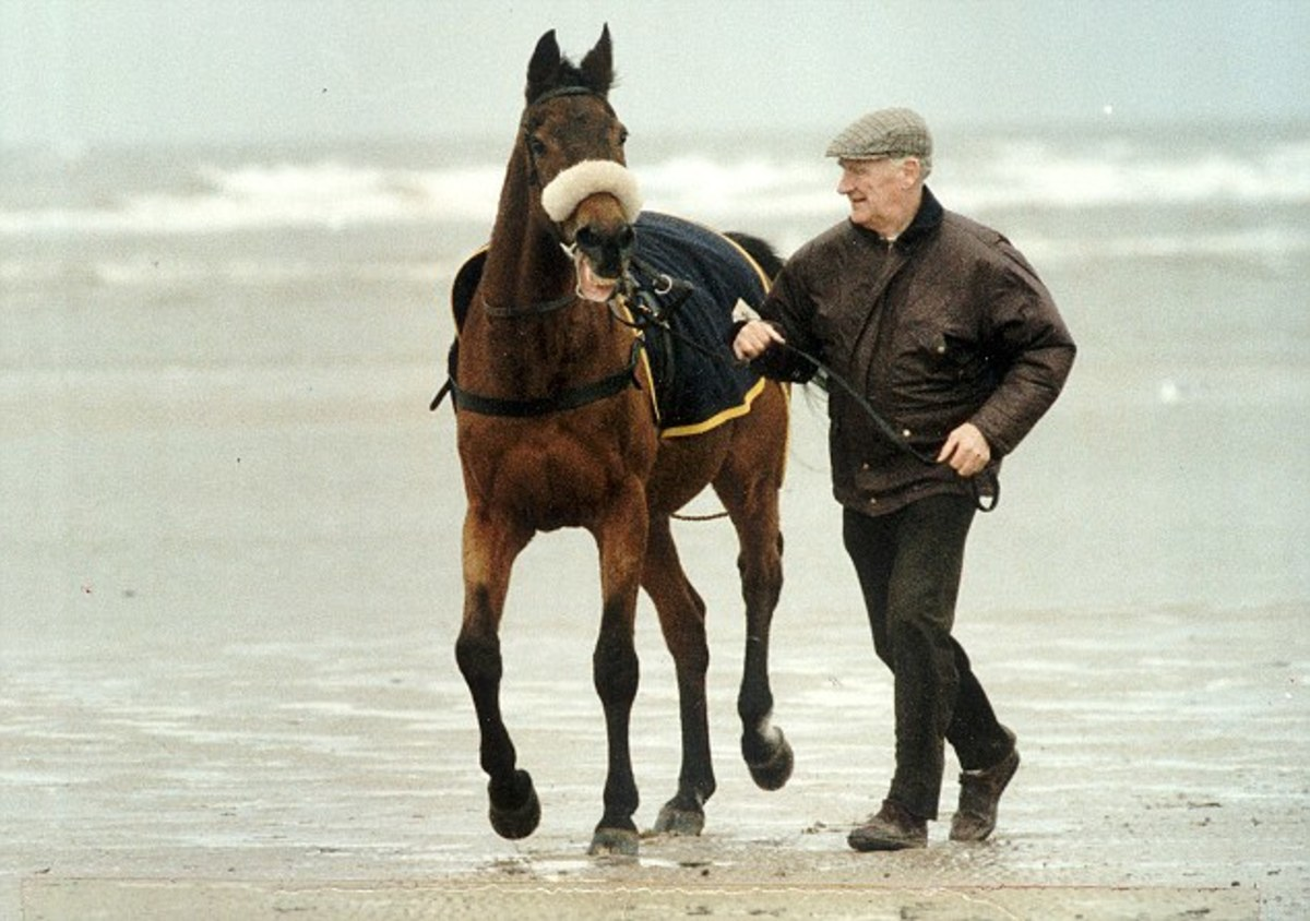 The famous racehorse Red Rum, who was owned by Noel Le Mere, is exercised on the beach by his late trainer Ginger McCain.