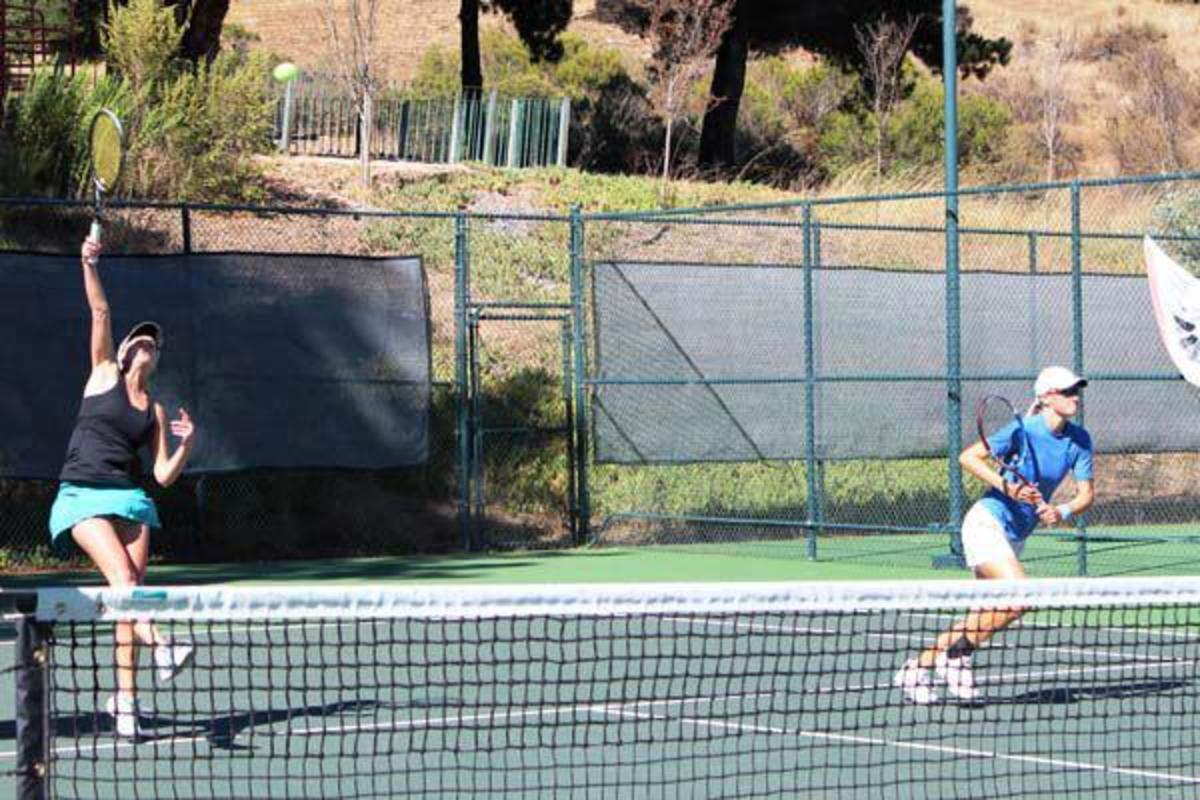 The author (pictured right) closing the net behind her partner's overhead at the 2011 NorCal Sectional Championships. As a result of playing this event, Micki received a B designation after her 5.0 rating.