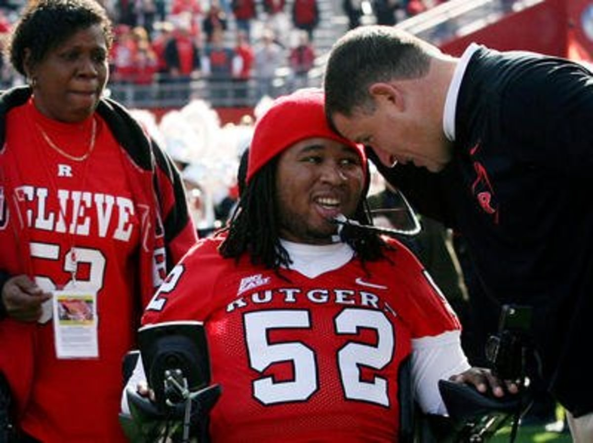 Eric LeGrand with coach Schiano and his mother