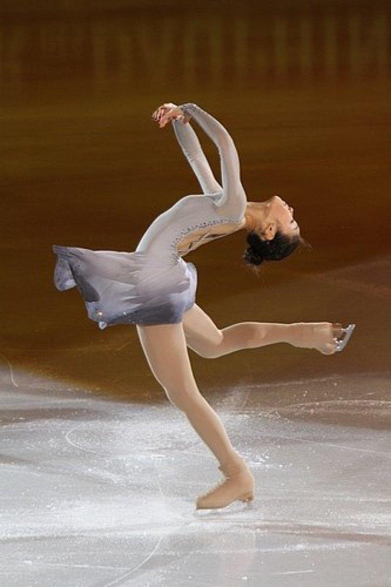Yu Na Kim performing a layback spin.