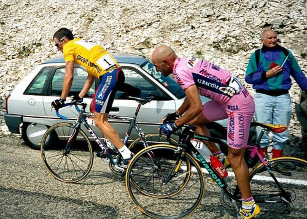 Lance Armstrong climbing ahead of Marco Pantani. Lance Armstrong is on a Trek OCLV Madone with Mavic Ksyrium wheels and Shimano Dura ace components