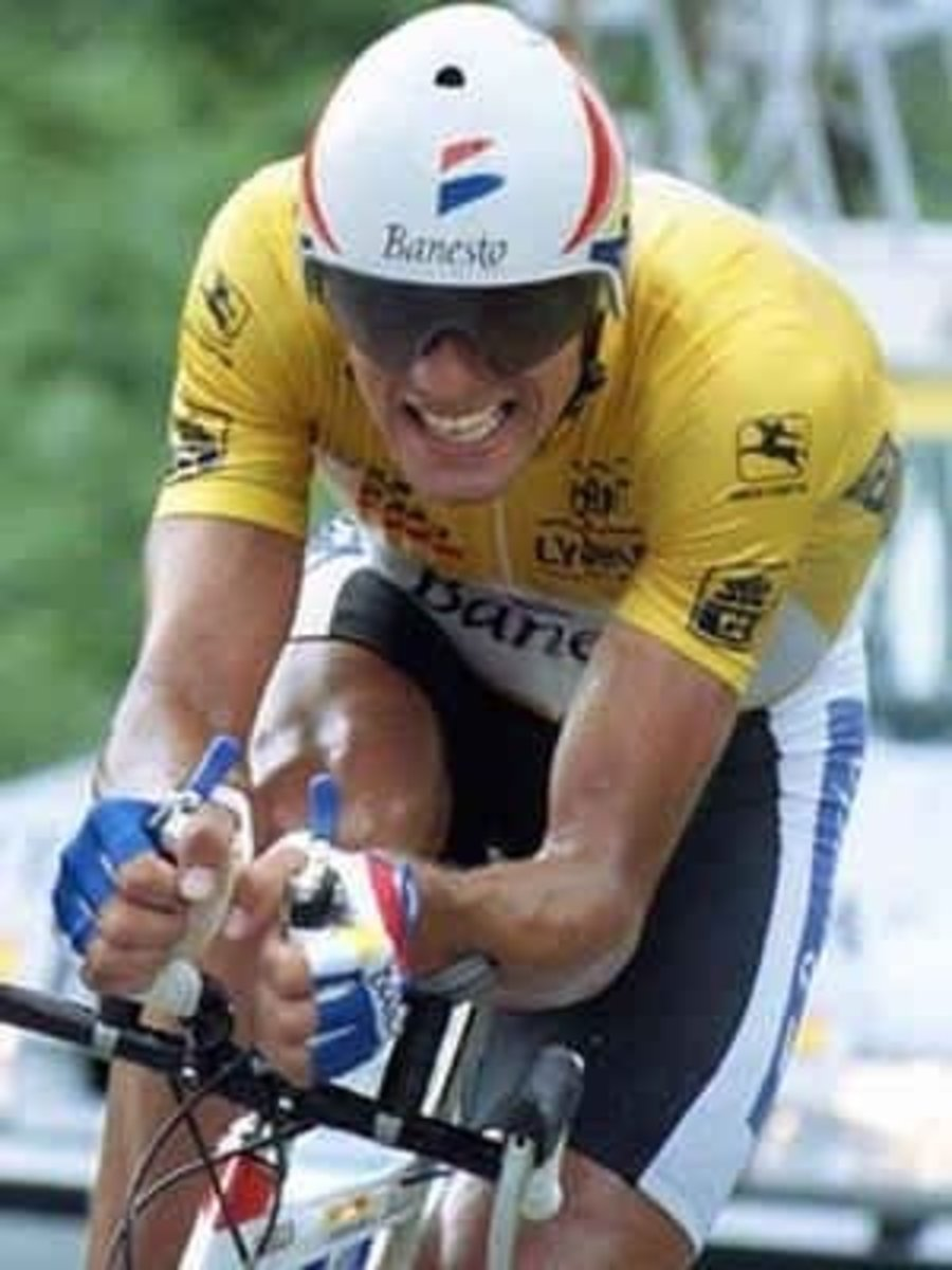 Indurain in yellow leading the Tour De France during a Time Trial stage while riding a Pinarello.