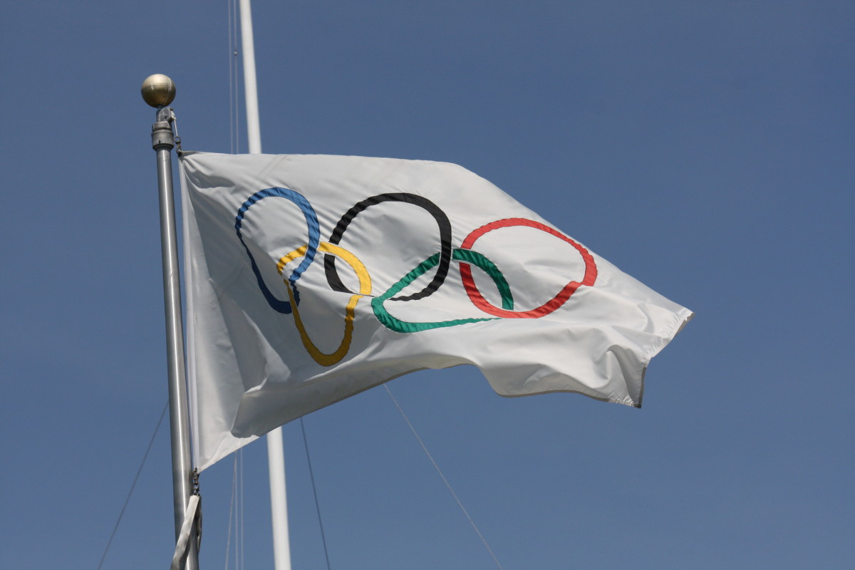 The Olympic Flag flying outside the Parliament Building in British Columbia.