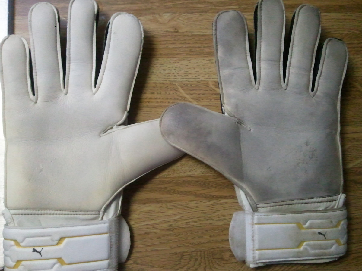 Washed (left) and dirty (right) goalkeeper gloves