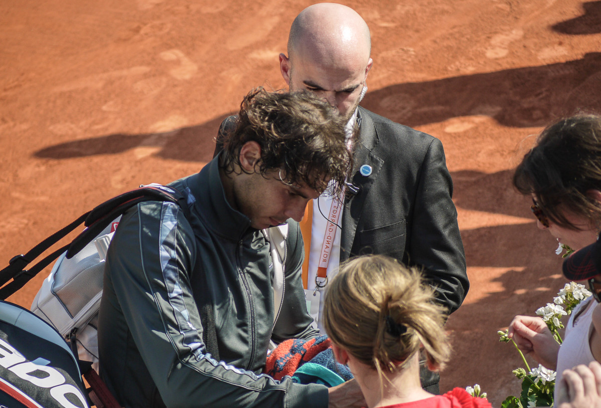 Nadal signing autographs.