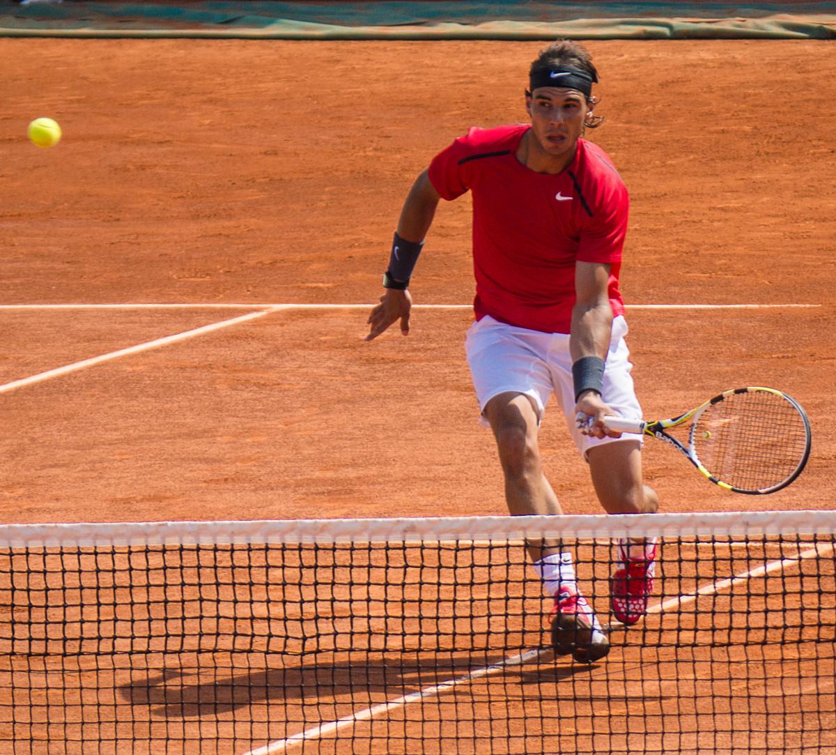 Nadal preparing to volley.