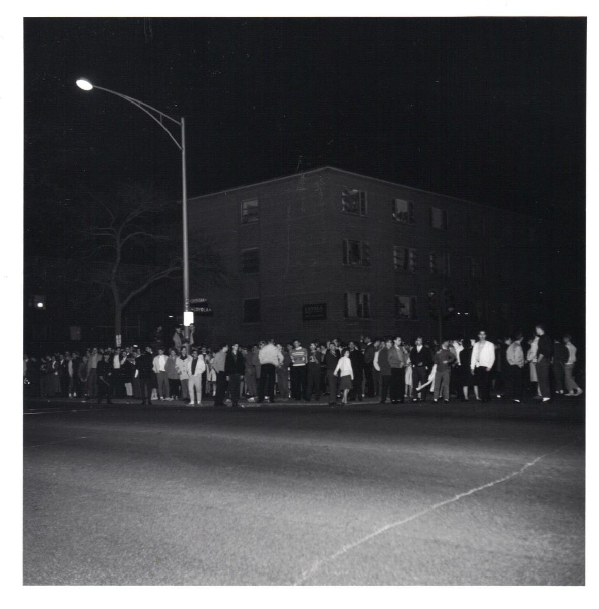 Students line Sheridan Road celebrating Loyola's National Basketball Championship on March 23, 1963.