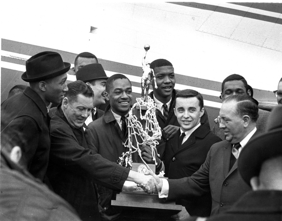 Loyola players arrive at O'Hare on March 24, 1963.  Front row, L-R: Vic Rouse, Coach George Ireland, Jerry Harkness, Les Hunter, John Egan, Mayor Richard J. Daley.
