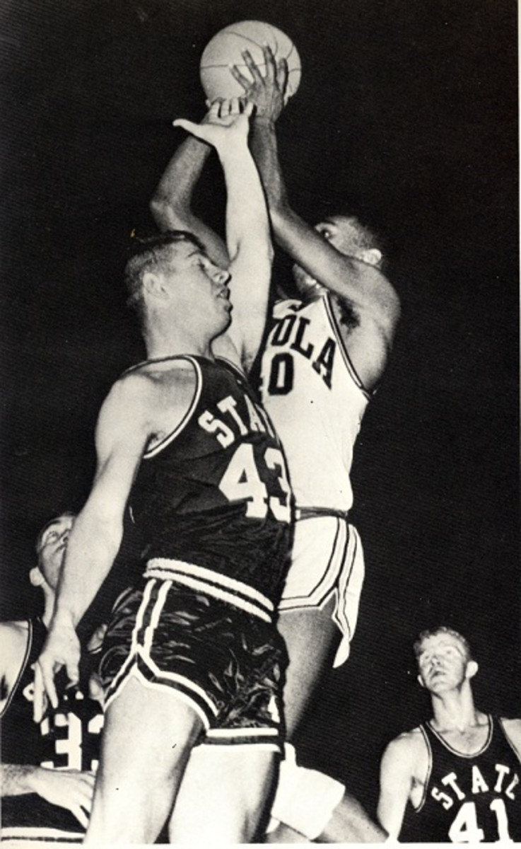 Loyola forward Vic Rouse skies for a rebound against Mississippi State in the 1963 NCAA Tournament.